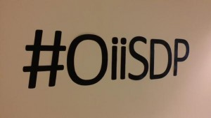 Figure 2. Hashtag wall-art photo by Homero Gil de Zuniga. Wall stickers spelling out the conference hashtag: #OiiSDP