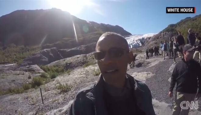 President Obama takes a 'Selfie' video with a glacier. Courtesy of CNN.com