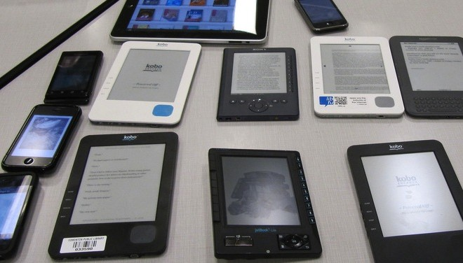 This is an image of many different kinds of e-readers.