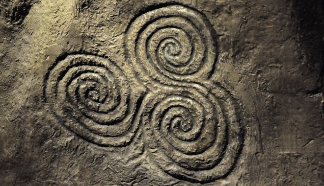 This is an image of three spirals carved into stone.