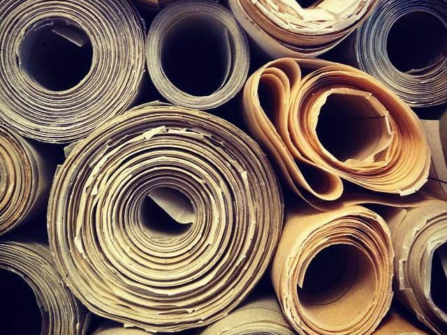 A stack of rolled drawings, viewed in profile.