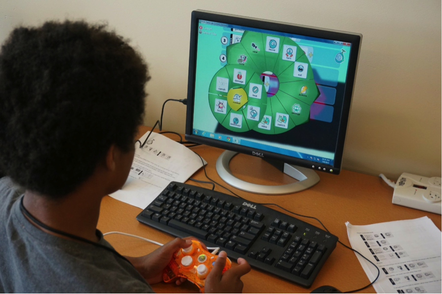Figure 3: An image of a student sitting in front of a computer, designing a video game.