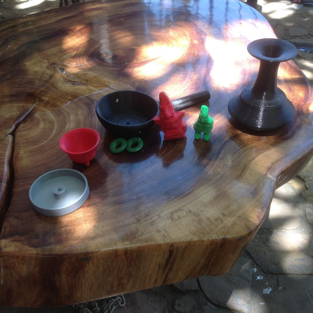 Figure 12 - Closer view of the table in figure 11, showing different 3D printed objects, including vessels and small figurines.