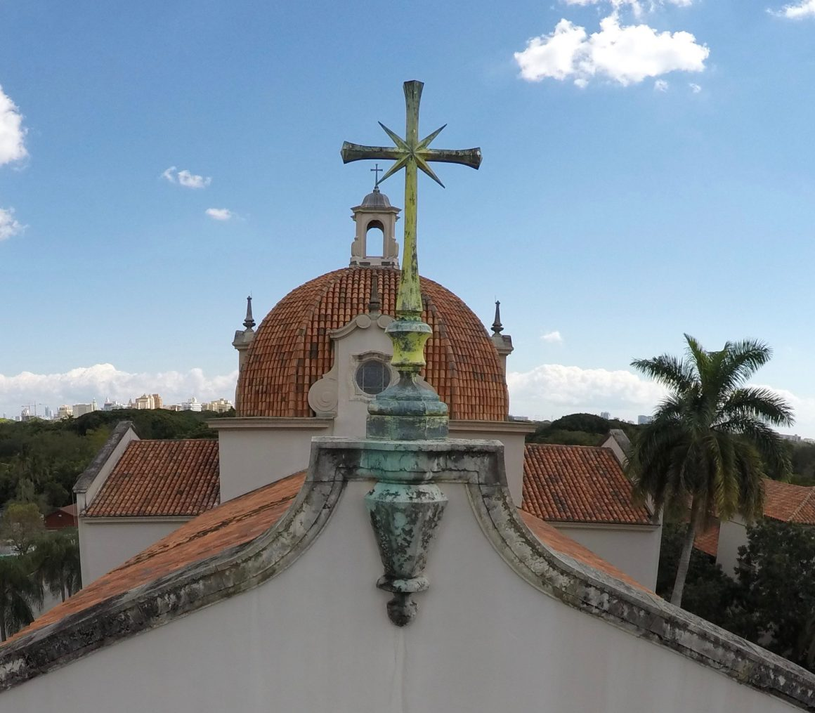 Drones can fly over spaces that are difficult to access by other means, as seen in aerial view of the Church of the Little Flower's tall dome and cross located at the pinnacle of the western façade.
