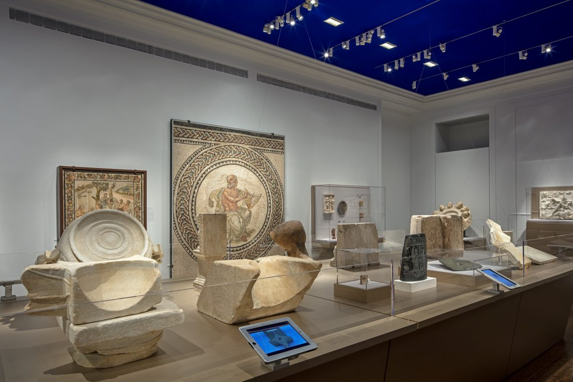 Installation view from Time and Cosmos in Greco-Roman Antiquity, 2016. The Delos Double Spherical Sundial is at the left, with animation running on nearby iPad. There are no visitors shown in this image.