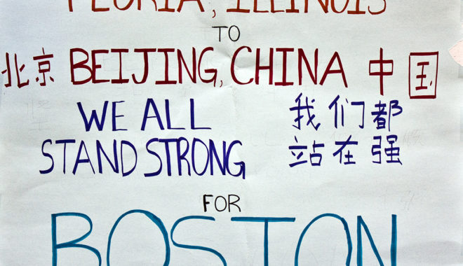"""Figure 1. Digital image of a poster left at the Boston Marathon memorial in Copley Square. The poster reads """"From Peoria Illinois to Beijing China, we all stand strong for Boston"""" in both English and Chinese (http://hdl.handle.net/2047/D20262219)."""