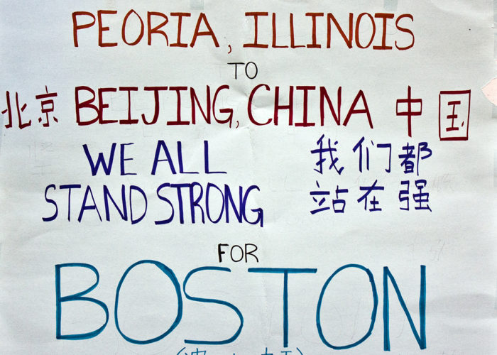 "Figure 1. Digital image of a poster left at the Boston Marathon memorial in Copley Square. The poster reads ""From Peoria Illinois to Beijing China, we all stand strong for Boston"" in both English and Chinese (http://hdl.handle.net/2047/D20262219)."