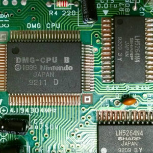 a closeup of a circuit board with several visible chips