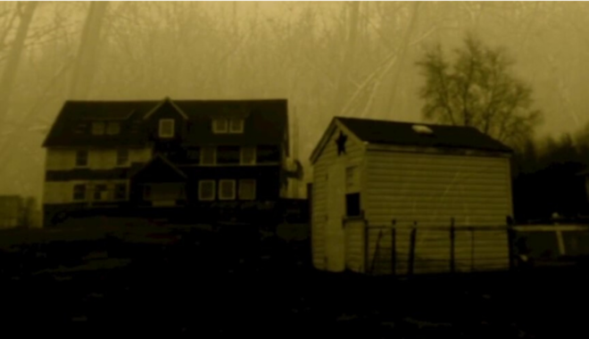 Two rural buildings dimly photographed in sepia tone.