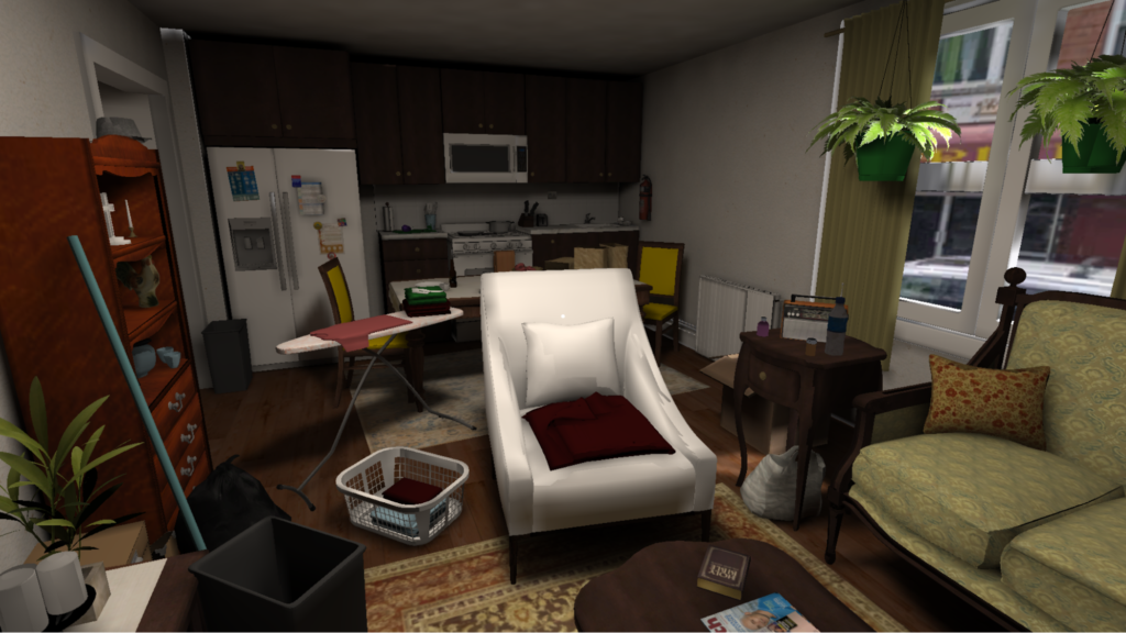 The image shows an open concept kitchen and living room area. A refrigerator, stove and cabinets are seen in the kitchen area. A sofa, recliner chair, bookshelves and plants are seen in the living room area. The room is purposely cluttered with books, laundry and cleaning items.