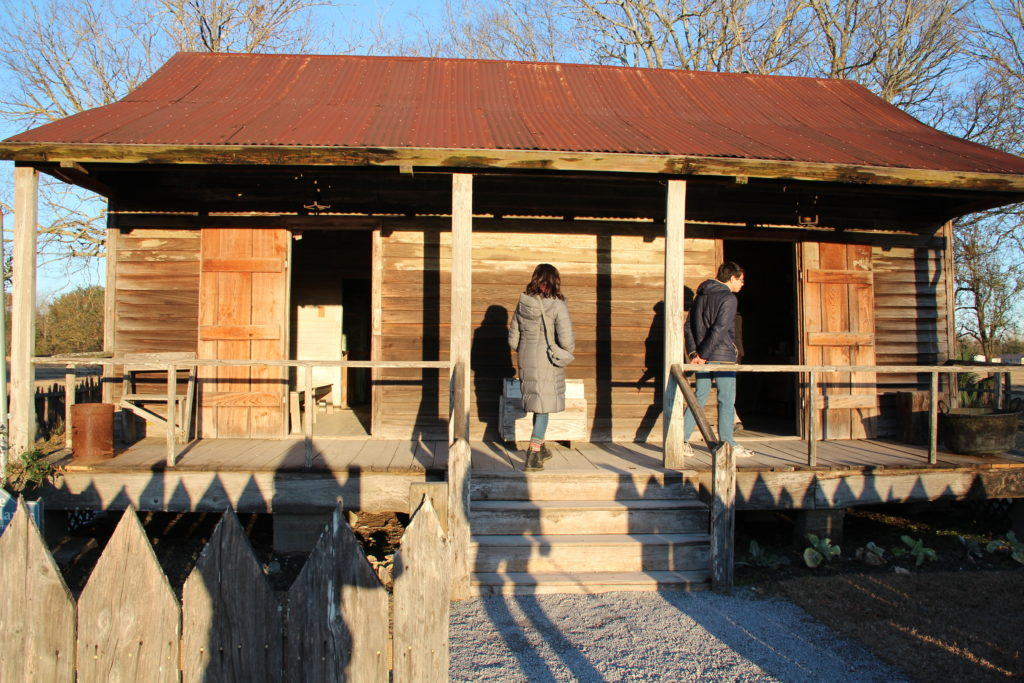 Grinnell College students examine a double-pen slave cabin in Vacherie, Louisiana.