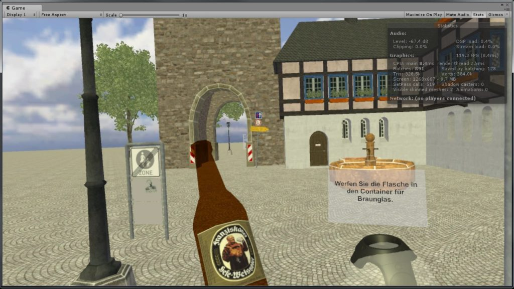Screen capture from the German VR project showing a German public space, a beer bottle, and a VR hand controller with directions in German.