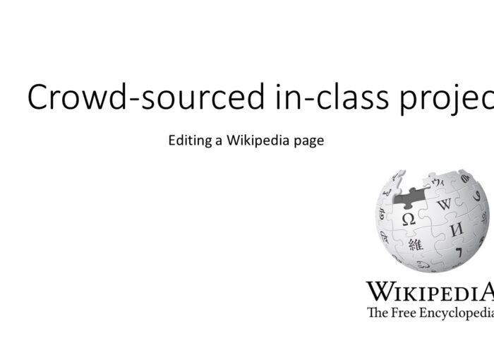"Powerpoint slide reading ""Crowd-sourced in-class project"", featuring the Wikipedia globe logo."
