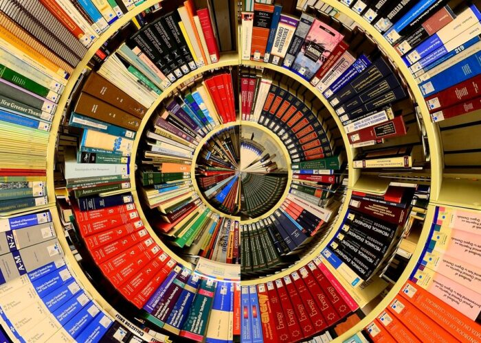 A spiral of books on library shelves appears almost as though a pie chart.