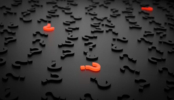 A computer-rendered pile of black question marks on a black background is punctuated by three scattered orange question marks that glow.