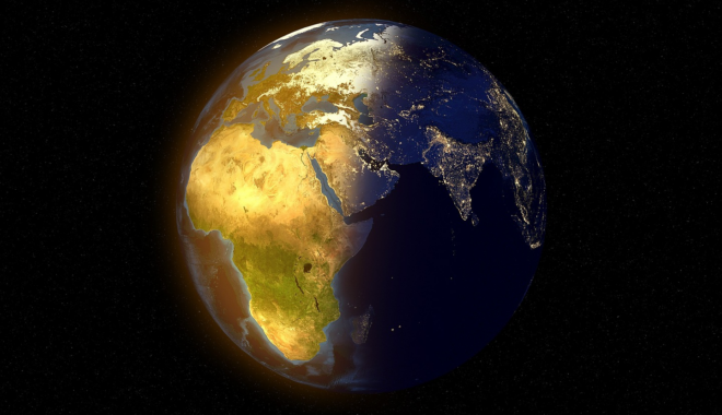 Earth viewed from space, with Africa lit up in the sun.